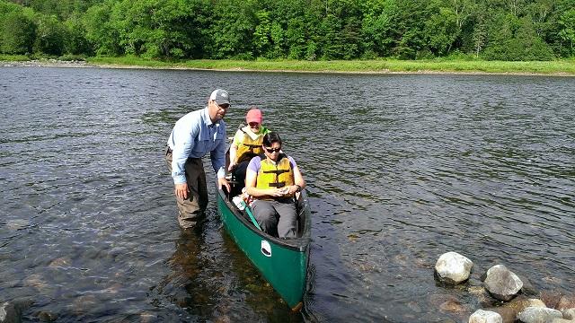 Canoe crossing Kennebec River